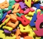 Numerology Interpretations - get some true insights into your life through the wisdom of numerology. Photo of coloured letters.